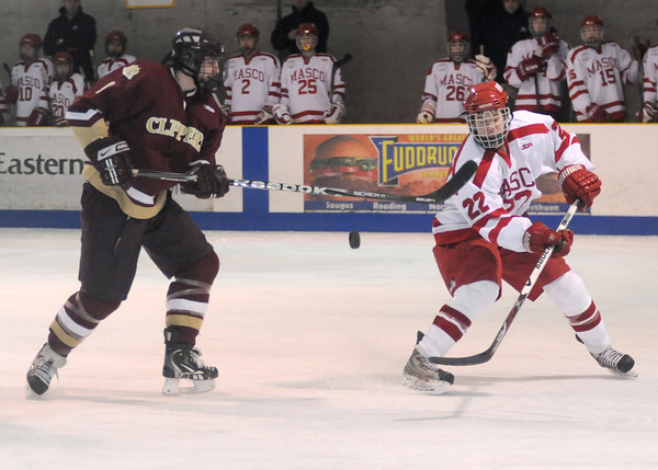 haverhill: Newburyport's Kristopher Holmes and Masco's Scott Woods fight to control the puck during their game in Haverhill Saturday. Jim Vaiknoras/Staff photo