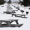 Salisbury: With only a few weeks left till spring, the snow covered picnic tables and grills at Salisbury Beach Reservation appear to remain in the firm grip of winter. Jim Vaiknoras/Staff photo