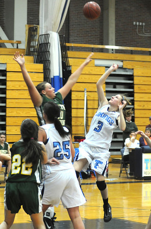 Byfield: Triton's Alyssa Conley shoots over a North Reading player during the Viking game at home against North Reading. Jim Vaiknoras/Staff photo