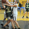 Byfield: Triton's Alison Towns fights for the ball with a North Reading player during their game at Triton Thursday night. Jim Vaiknoras/Staff photo
