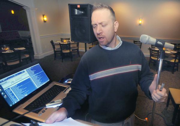 Salisbury: David Kavinlaug, AKA DJ Davey K, owner of Spot Rock entertainment asks question at trivia night at Capri in Salisbury Thursday night. Jim Vaiknras/Staff photo