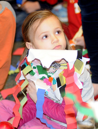 Salisbury: Kindergatener Samantha Connolly waits with her dragon mask  for the Salisbury Elementary School Dragon Parade Friday. Student spend the day celebrating Chinese New Years by learning Chinese dance, making Moon Cakes, and eating Chinese Food. Jim Vaiknoras/Staff photo