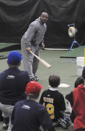 Salisbury:Cleveland Indians hitting instructor Jon Nunnally leads a hitting clinic, sponsored by CoreAthletics, at Extra Innings in Salisbury Saturday afternoon. Jim Vaiknoras/Staff photo