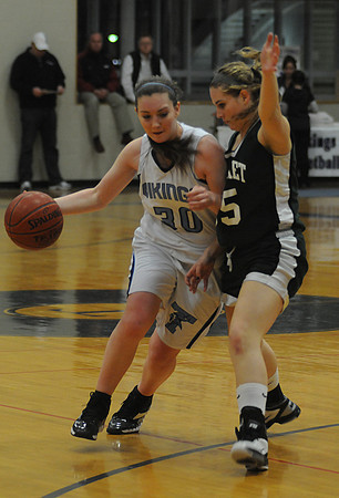 Byfield: Triton's Jessica Canning drives on Pentucket's Tori Lane during their game Thursday night at Triton. Jim Vaiknoras/Staff photo