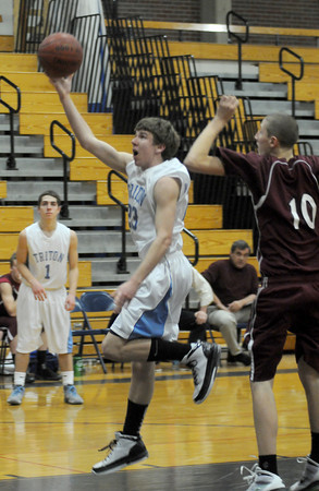 Byfield: Triton's Cal Kneeland scores with a fingerroll against Rockport Friday night. Jim Vaiknoras/Staff photo