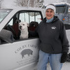 Newbury: Lisa Colby with her dog Boomer at the Colby Farm in Newbury. Jim Vaiknoras/Staff photo