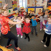 Salisbury: Ashley Fraser teaches kindergateners Chinese dance at the Salisbury Elementary School Friday. Student spend the day celebrating Chinese New Years with a Dragon Parade, making Moon Cakes, and eating Chinese Food. Jim Vaiknoras/Staff photo