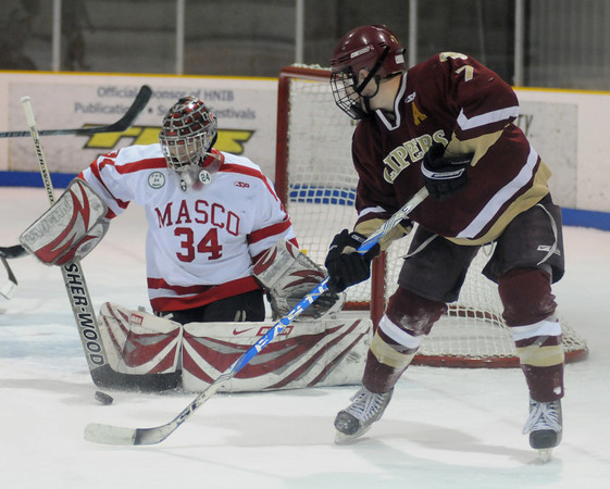 haverhill:Masco goalie Casey Tudor stops a shot by Newburyport's Gaven LaValley during their game in Haverhill Saturday. Jim Vaiknoras/Staff photo