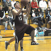 byfield: Rockport's Phillip MacArthur drives the lane at Triton Friday night. Jim Vaiknoras/Staff photo