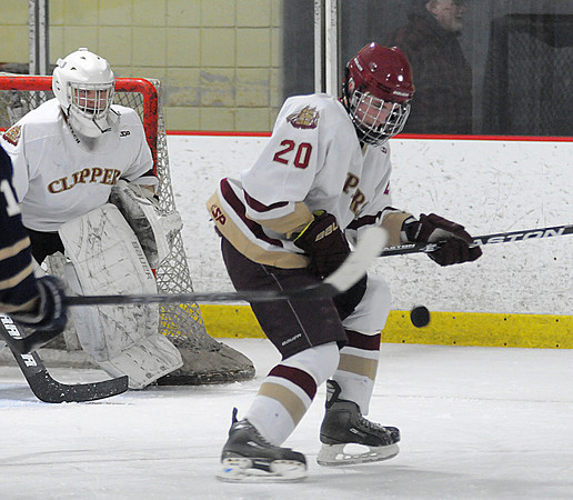 Newburyport: Newburyport's Sean Dillon knocks down the puck against St Mary's during their game in the final of the Newburyport Bank 16th Annual Hockey Tournament. JIm Vaiknoras/Staff photo