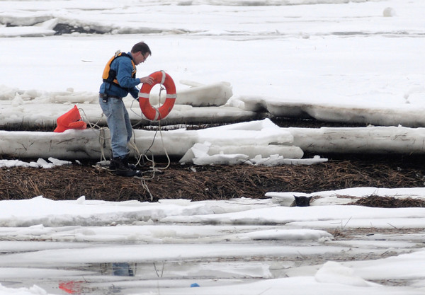 Newbury: Newbury firefighter Tim Wareham rescues a dog that was stuck on the ice in Plum Island basin Saturday afternoon. JIm Vaiknoras/STaff photo