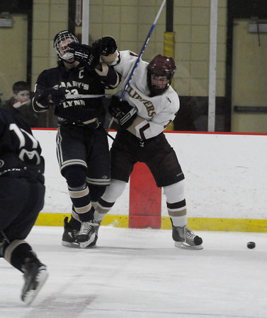 Newburyport: Newburyport's Cooper Hines checks St Mary's Cam Kennedy off the puck during their game in the final of the Newburyport Bank 16th Annual Hockey Tournament. JIm Vaiknoras/Staff photo