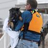 Newbury: Newbury firefighter Tim Wareham rescues a dog that was stuck on the ice in Plum Island basin Saturday afternoon. JIm Vaiknoras/STaff photo