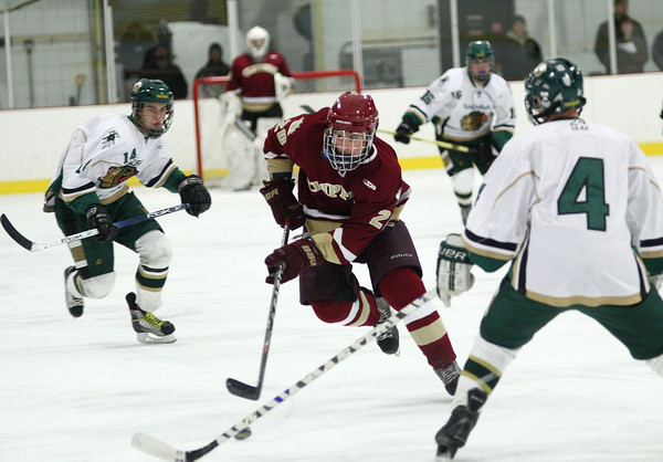 Haverhill: Newburyport's Sean Dillon (20) streaks down the center of the ice during Monday night's 3-1 win over Pentucket in Haverhill. Photo by Ben Laing/Staff Photo