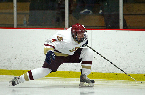 Newburyport: Cam Roy (4) celebrates after notching his second goal of the evening Wednesday night, as he lead Newburyport to a 5-3 win over Masconomet with a hat trick and an assist. Photo by Ben Laing/Staff Photo