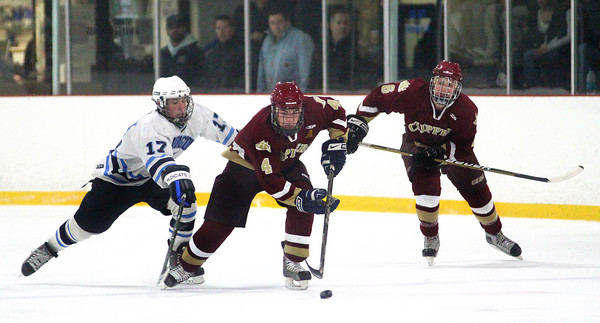 Wilmington: Newburyport's Cam Roy (4) pulls away from Wilmington's Dalton Rolli (17) during Monday afternoon's 2-2 tie at Ristuccia Arena. Photo by Ben Laing/Staff Photo