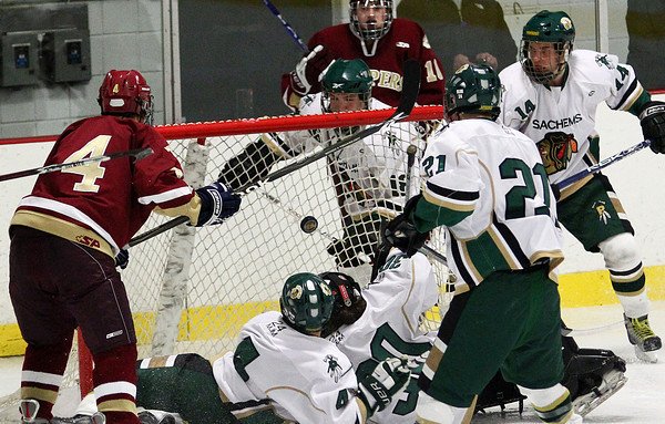 Haverhill: Pentucket goalie Samantha Bomba (30) and defenseman Ryan McCarthy (4) watch the puck float into the net after a shot by Newburyport's Cam Roy (4) during Monday night's game in Haverhill. Photo by Ben Laing/Staff Photo