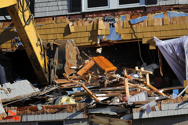 Newbury: An excevator demolishes the home at 27 Annapolis Way Monday afternoon, after the dune in front of the home became eroded and damaged the foundation. Photo by Ben Laing/Staff Photo