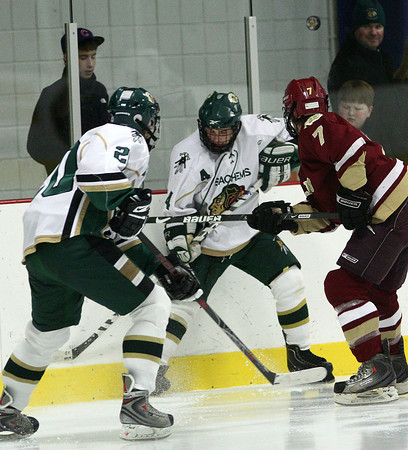 Haverhill: Pentucket's Ryan McCarthy (4) battles for a loose puck along the boards Monday night, as the Sachems hosted Newburyport. Photo by Ben Laing/Staff Photo