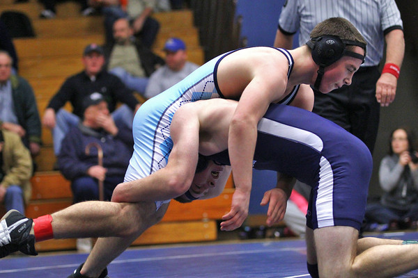 Byfield: Triton's Tim Cashman (bottom) upends Wilmington's Jim Kendall during Tuesday afternoon's wrestling match in Byfield. Photo by Ben Laing/Staff Photo
