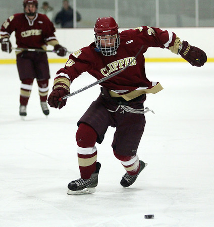 Haverhill: Newburyport's Sean Dillon (20) scrambles for a loose puck during Monday night's 3-1 win over Pentucket at Haverhill. Photo by Ben Laing/Staff Photo