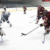 Wilmington: Newburyport's Kris Holmes (9) jumps on a loose puck in front of Wilmington goalie Joseph Aucoin (30) during Monday afternoon's 2-2 draw at Ristuccia Arena. Photo by Ben Laing/Staff Photo