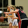 Byfield: Alison Towns (1) of Triton is hassled by two North Andover defenders during Tuesday night's game in Byfield. Photo by Ben Laing/Staff Photo