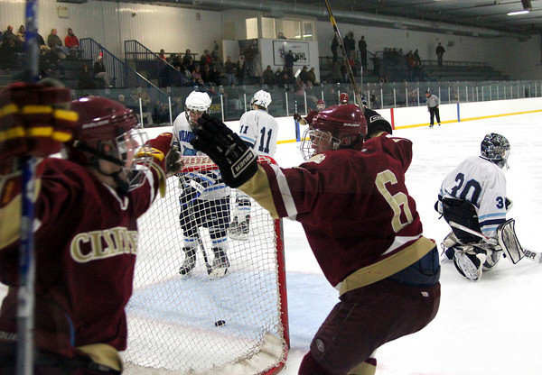 Wilmington: Newburyport's Nate Hickman (10) and Connor Wile (6) celebrate the game tying goal by Cam Roy late in the third period of Monday's game against Wilmington. Photo by Ben Laing/Staff Photo