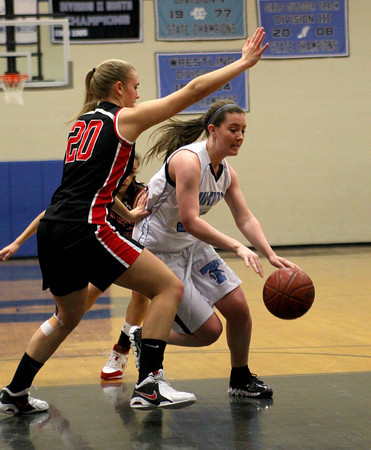 Byfield: Triton's Jessica Canning (30) drives past North Andover's Erika Zahoruiko (20) during Tuesday night's game in Byfield. Photo by Ben Laing/Staff Photo