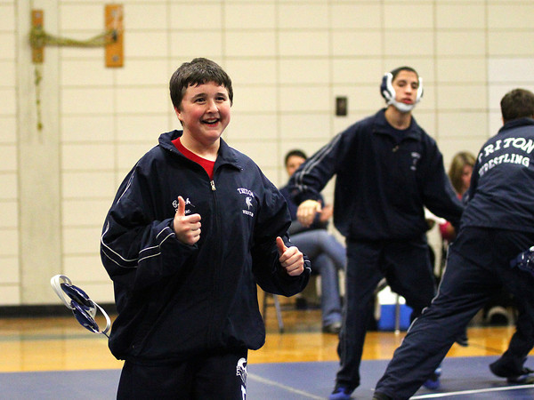 Byfield: Nick Johnson of Triton takes a lap with the varsity wrestling team Wednesday afternoon before their match with Saugus-Winthrop. Photo by Ben Laing/Staff Photo