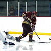 Wilmington: A diving Wilmington player tries to disrupt a shot from Newburyport's Dominic Ferreira (16) during Monday afternoon's 2-2 tie at Ristuccia Arena. Photo by Ben Laing/Staff Photo