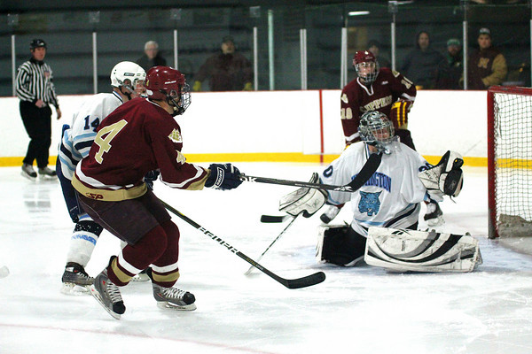 Wilmington: Cam Roy (4) of Newburyport fires a shot just wide of Wilmington goalie Joseph Aucoin Monday afternoon as the Clippers battled back to tie their hosts 2-2. Photo by Ben Laing/Staff Photo