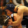 Byfield: Triton's Pat Flynn, top, grapples with a Hamilton-Wenham wrestler during Tuesday's meet at Triton High. Photo by Ben Laing/Staff Photo