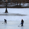 Newburyport: A trio of ice skaters take to the Mall Monday afternoon to pass the puck around before dark. A clean sheet of ice will be hard to come by as the area is expected to get heavy snow on Wednesday. Photo by Ben Laing/Staff Photo