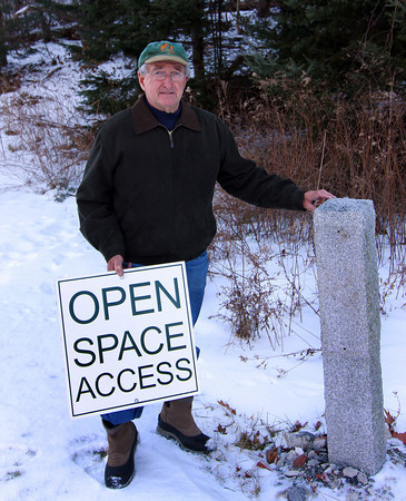 Amesbury: Ron Gagnon stands with a sign near the Amesbuy Powder House that was vandalized last week. It was the second time the sign has been vandalized. Photo by Ben Laing/Staff Photo
