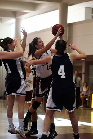 Newburyport: Newburyport's Molly Rowe (12) drives through the Cohasset defense during Monday afternoon's game at Newburyport High. Photo by Ben Laing/Staff Photo