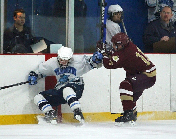 Wilmington: Newburyport's Dominic Ferreira (16) knocks a Wilmington player into the boards during Monday afternoon's 2-2 tie at Ristuccia Arena. Photo by Ben Laing/Staff Photo