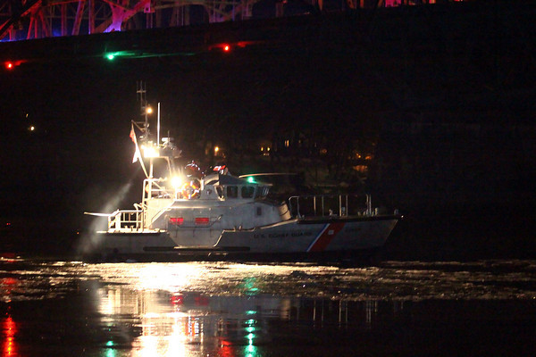 Newburyport: A Coast Guard vessel searches the waters near the Whittier Bridge Monday night as reports came in that a car drove off the bridge and into the Merrimac River. Photo by Ben Laing/Staff Photo