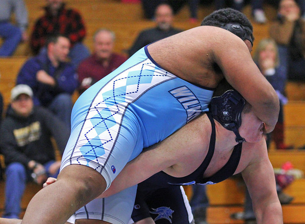 Byfield: Triton's Andrew McManus (bottom) gets a face full of a Wilmington wrestler during Tuesday afternoon's wrestling match in Byfield. Photo by Ben Laing/Staff Photo