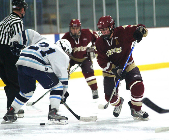 Wilmington: Newburyport centerman Gaven LaValley (7) wins a face off against Wilmington's Luke Foley (21) during Monday afternoon's 2-2 tie. Photo by Ben Laing/Staff Photo