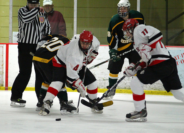 Amesbury: Amesbury captain Zach Pizzo (4) wins a face off in the North Reading end of the ice during Wednesday night's game at the Graf Rink. Photo by Ben Laing/Staff Photo