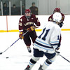 Wilmington: Newburyport's Nate Hickman (10) moves the puck up the ice during Monday afternoon's 2-2 tie at Wilmington. Photo by Ben Laing/Staff Photo