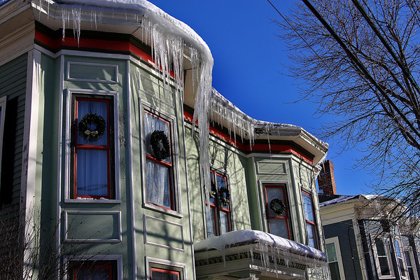 Newburyport: A massive icicle forms on a house on High Street in Newburyport, where sunshine has begun to melt the snow left on the roofs of many houses in town. Photo by Ben Laing/Staff Photo