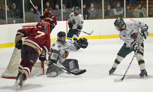 Haverhill: Pentucket goalie Samantha Bomba (30) robs Newburyport's Gaven LaValley (7) on a one timer Monday night in Haverhill. The Clippers would edge out the Sachems, 3-1. Photo by Ben Laing/Staff Photo