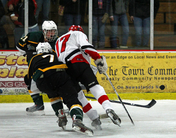 Newburyport: Amesbury's Zachary Bolduc (17) lays a hit on North Reading's Jeremy Buckley (7) during Wendesday night's game at the Graf Rink. Photo by Ben Laing/Staff Photo