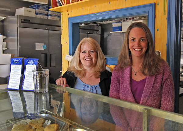 Newburyport: Rhonda Weisheit, right, has sold her bakery, Pralines, in downtown Newburyport to Lee Coughlin, left, of Amesbury. Photo by Ben Laing/Staff Photo