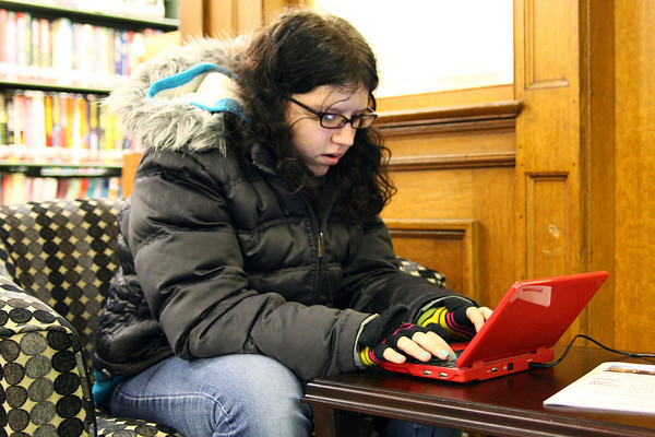 Amesbury: Rachel Mace, 13, of Amesbury, types away on her laptop device Wednesday afternoon at the Amesbury Public Library. Photo by Ben Laing/Staff Photo