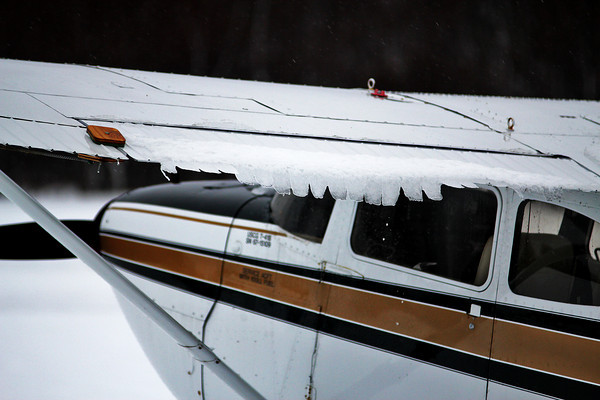 Newbury: Icicles begin to form on the wing of a plane at the Plum Island Airport Tuesday afternoon, as the heavy snowfall turned to rain later in the day. Photo by Ben Laing/Staff Photo