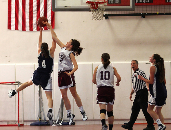 Newburyport: Newburyport's Samantha Leahy (32) tries to block a shot by a Cohasset player as the two teams squared off at Newburyport High School Monday afternoon. Photo by Ben Laing/Staff Photo