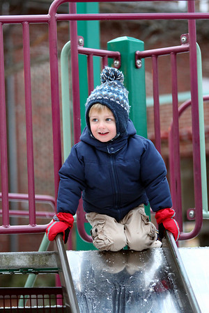 Newburyport: Brodie Proulx of Exeter, NH, prepares to take a trip down the slide at the tot lot on Inn Street in Newburyport Tuesday afternoon. Photo by Ben Laing/Staff Photo